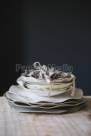 stcked plates and cutlery on a