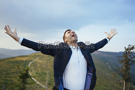 screaming businessman standing on top of