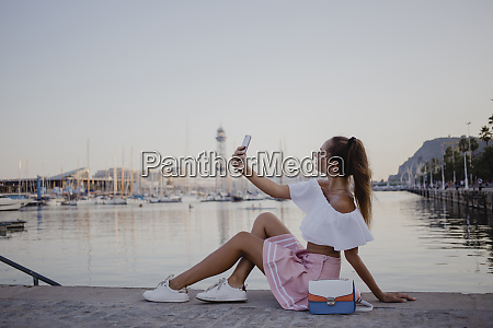 fashionalble young woman sitting at the