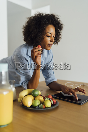 woman using digital tablet and having