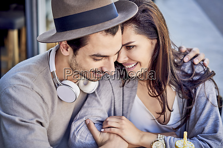 happy affectionate young couple cuddling outdoors