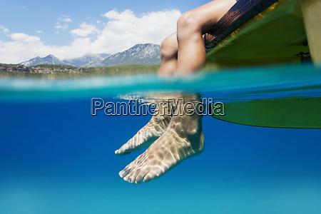 feet of a boy sitting on