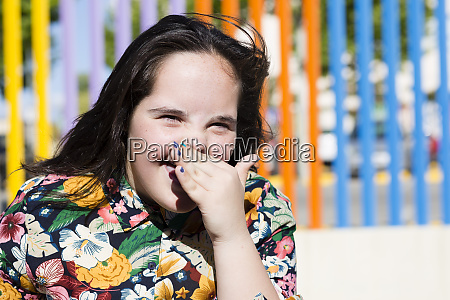 teenager girl with down syndrome laughing