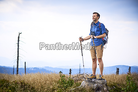 man admiring the view during hiking