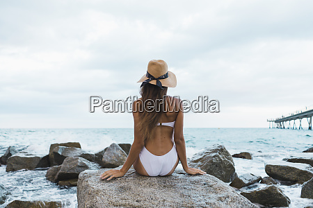 rear, view, of, young, woman, wearing - 26355380