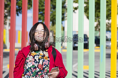 teenager with down syndrome using smartphone