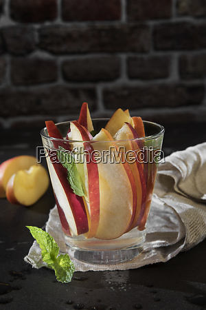 glass of detox water with sliced