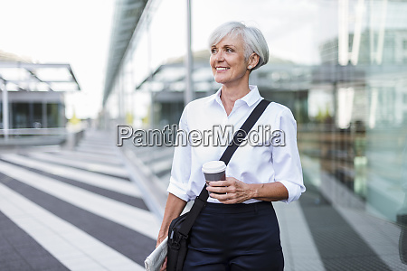 smiling senior businesswoman in the city