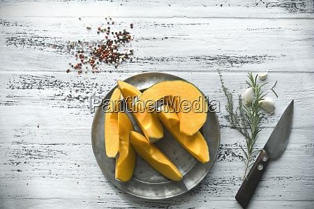 sliced cucurbita maxima on tin plate