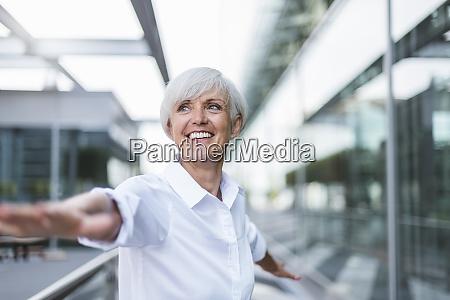 happy senior woman in the city