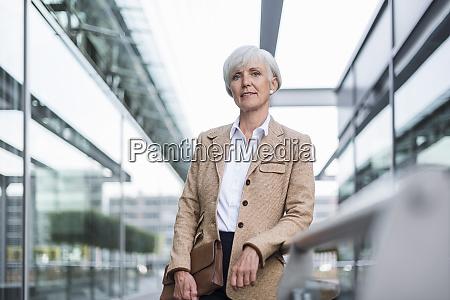 portrait of confident senior businesswoman leaning