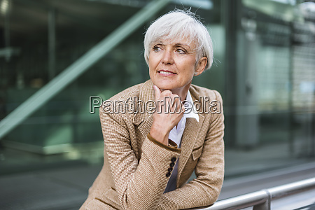 portrait of senior businesswoman leaning on