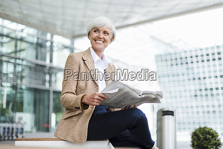 smiling senior businesswoman sitting in the