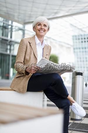 smiling senior businesswoman sitting in the