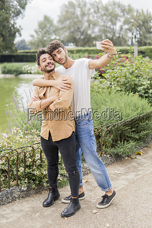 portrait of young gay couple taking