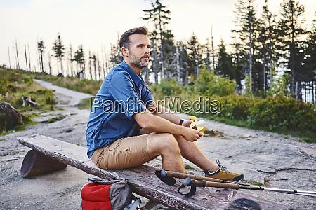 man resting on bench having a