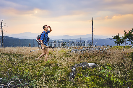 man hiking in the mountains at
