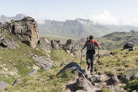 russia caucasus mountaineer hiking in upper