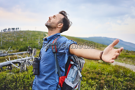 man with closed eyes enjoying beautiful