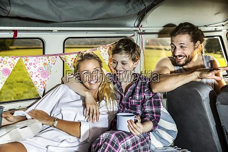 happy friends inside a van enjoying