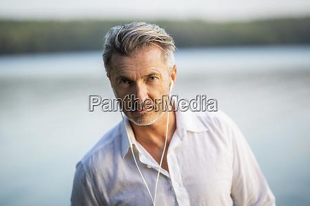 portrait of mature man with earphones