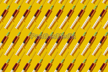 multiple syringes organized in a pattern