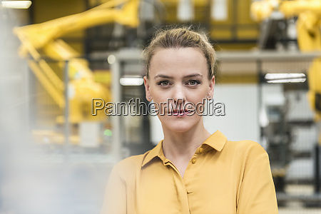 portrait of confident woman in factory