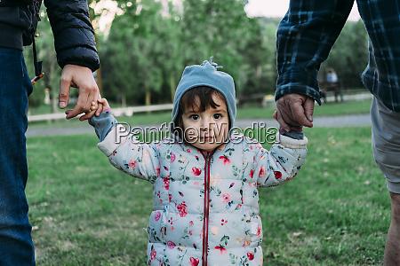 portrait of fashionable little girl walking