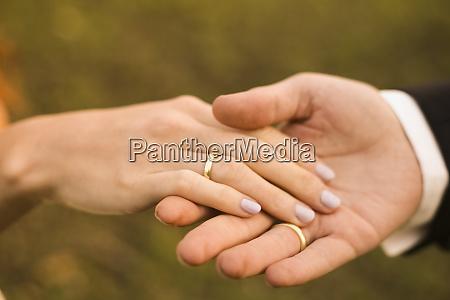bridal couple holding hands showing wedding