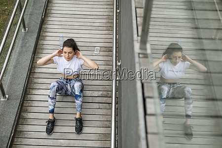 young woman doing situps on a