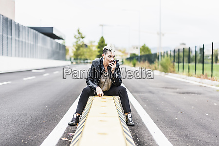 punk woman sitting at the roadside