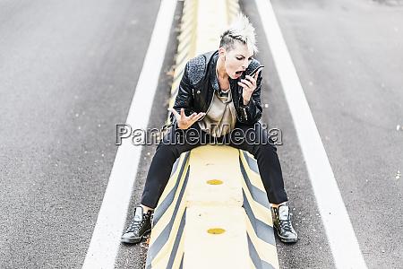 aggressive punk woman sitting at the