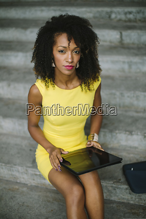 portrait of fashionable businesswoman in yellow