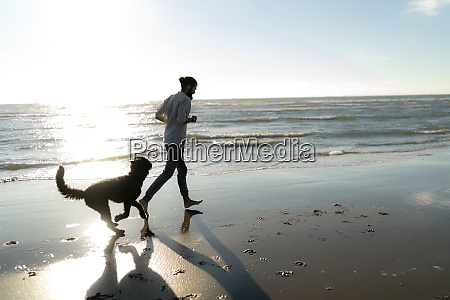 young man running and playing with