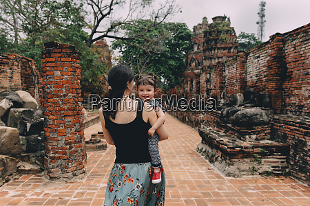 thailand ayutthaya mother and daughter walking
