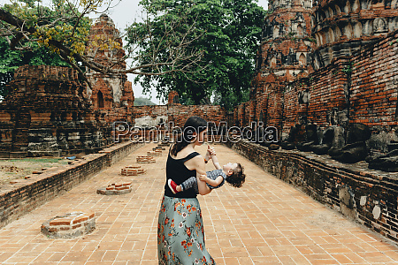 thailand ayutthaya mother and daughter playing