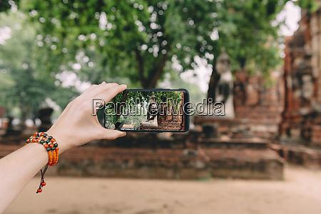 thailand ayutthaya woman taking a photo