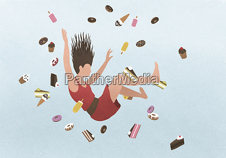 a woman falling amongst sweet junk