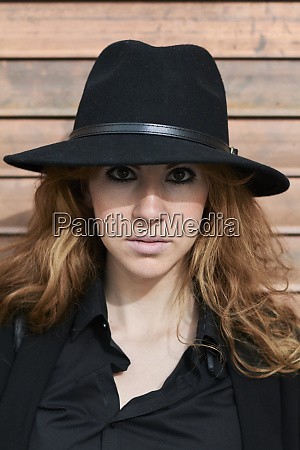 mid adult woman wearing black hat