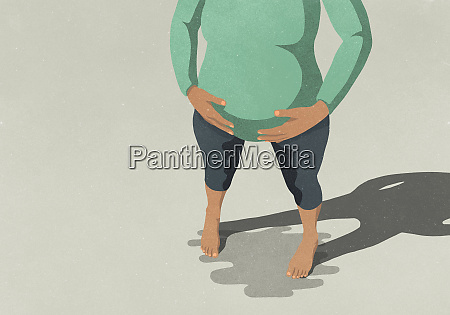 low section of pregnant woman standing