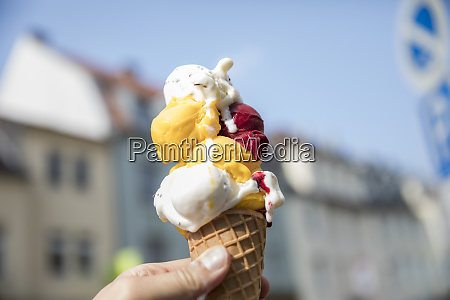 hand holding ice cream cone with