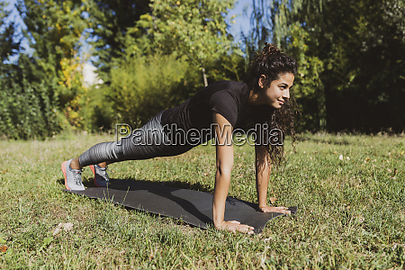 sporty young woman doing push ups