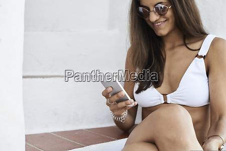smiling young woman wearing white bikini