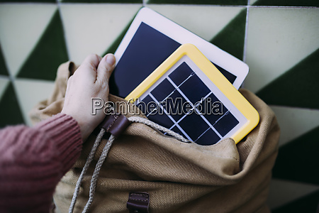 woman putting a tablet into a