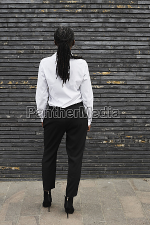 back view of businesswoman with dreadlocks