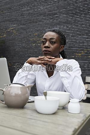 portrait of pensive businesswoman sitting on