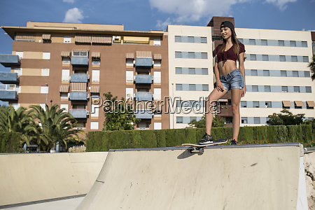 young pretty woman standing on skate