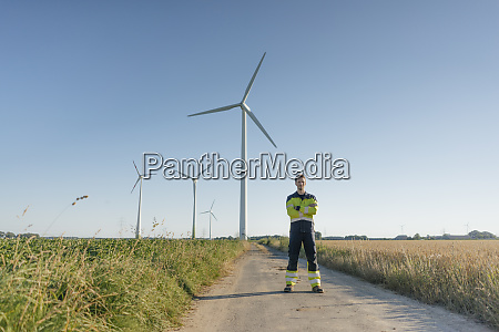 engineer standing on field path at
