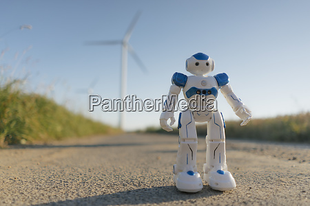 robot standing on field path at