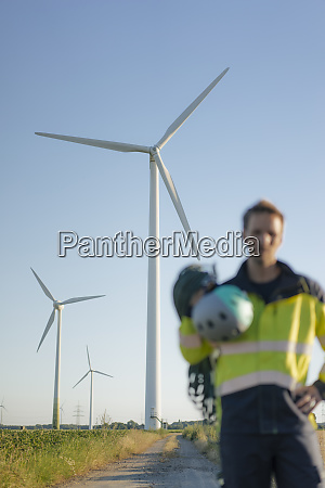 blurred view of technician standing on